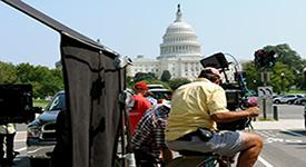 Director filming the Capitol